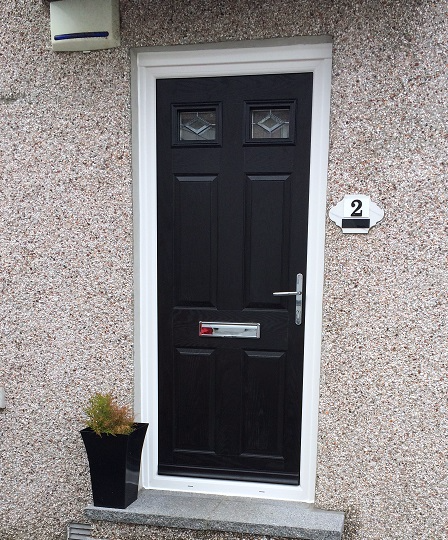 A New U0027Au0027 Rated 70mm Rebated Composite Door Replacing The Older PVC Style  Doors.